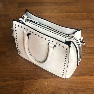 Studded hand bag